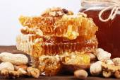 Honeycomb and honey on a wooden surface — Stock Photo