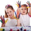 Portrait of two cheerful girls show their hands painted in bright colors — Stock Photo #58763121