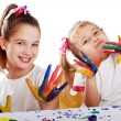 Portrait of two cheerful girls show their hands painted in bright colors — Stock Photo #59014815