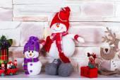 Snowmen on the mantelpiece — Stock Photo