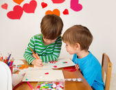 Kids engaged in Valentine's Day Arts with Hearts — Stock Photo