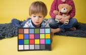 Child Holding Photography Color Checker Card — Stock Photo