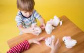 Kids playing with Easter Bunny Toys — Stock Photo