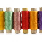 Several spools of colored threads — Stock Photo