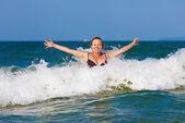 Woman in wave — Foto de Stock