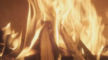Closeup of fireplace with burning wood shot in slow motion handheld camera tilting 100 fps indoors  burning sticks of fire in slow motion 100 frame per second at home tilting up and down — Stock Video