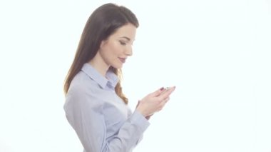 Woman holding a phone with happy reaction reading sms message isolated on white — Stock Video