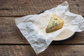 Cheese with a blue mold on the paper — Stock Photo