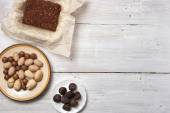 Nuts, truffle candy and chocolate cake on the white background — Foto de Stock