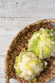 Two cauliflowers in the basket on the white background — ストック写真