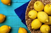 Lemons on the bright cyan background — Stock Photo