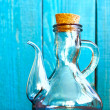 A glass vintage oiler on the blue background — Stock Photo #59200937