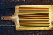 Raw pasta on the wooden board — Stock Photo