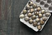 Quail eggs in the carbboard packing on the grey table — Foto Stock