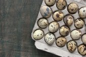 Quail eggs in the cardboard packing on the grey table — Foto Stock