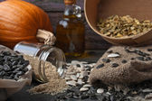 Sunflower and pumpkin seeds on the wooden table — Stock Photo