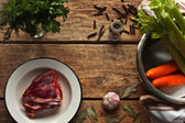 Ingredients for the meat broth on the wooden table — Stock Photo