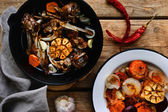 Ingredients for the broth from bones in the iron pot — Stock Photo