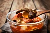 Broth from the bones and vegetables in the glass dish — Stock Photo
