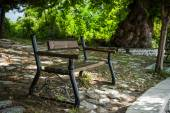 Empty bench in a greek park — Stock Photo