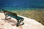Empty bench on the stone embankment — Stock Photo