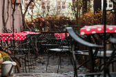 Nice street cafe at an autumn evening  — Stock Photo