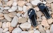 Slippers at the stone beach — Stock Photo