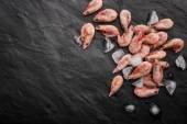 Frozen shrimps on the black stone table — Stock Photo