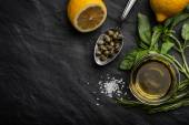 Olive oil with lemon , capers and different greens horizontal — Stock Photo