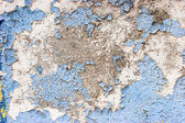 Old stone wall with cracked blue color paint background — Stock Photo
