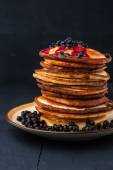 Pancakes with blueberry jam and berries on the wooden table — Stock Photo