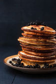 Pancakes with blueberries on the dark wooden table — Stock Photo