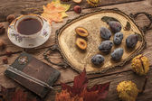 Autumnal still life with gift of nature , vintage notebook and tea with film filter effect — Stock Photo