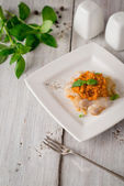 Cod with sauce romanesco on the white table with fork and basil — Stock Photo