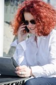 Portrait of a red haired woman outdoors — Stock Photo
