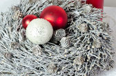 Advent wreath with snow and christmas balls — Stock Photo