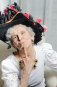 Old woman loves carnival and throws kiss — Stock Photo