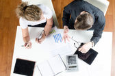 Team, man and woman planning revenues — Stock Photo