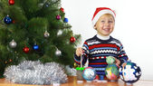 Boy paints the Christmas boll — Stock Photo