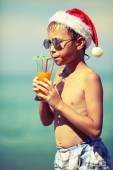 Boy in the hat of Santa Claus — Stock Photo