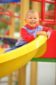 Child playing on the slide — Stock Photo