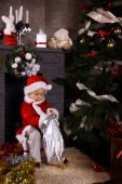 Little Santa Claus with gifts — Stock Photo