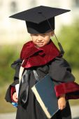 Funny little boy dressed as a graduate — Stock Photo