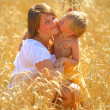 Woman with  child in a wheat field — Stock Photo #58512797