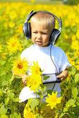 Funny baby in headphones with a tablet — Foto de Stock