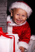 Baby Santa Claus with Christmas gifts — ストック写真