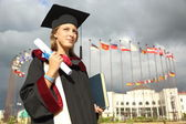 Graduate with a diploma — Stock Photo