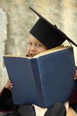 Funny little boy graduate of the University — Stock Photo