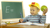 Funny boy on a physics lesson — Foto Stock