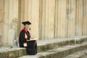 Woman scientist in ancient colonnade — Stock Photo